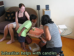 Sebastians helps with candles